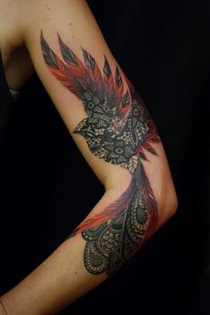 I kinda on the fence about tattoos but this was way too beautiful to pass up. The lace, the colors in the feathers... It the most artfully done tat I've seen in a while.
