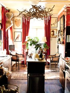 Love the twig and crystal fixture. (Home of Camille Price, as featured by And George. Photo by Christy Ford for And George.)