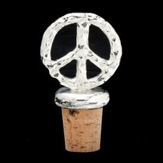 "Arthur Court Designs Peace Bottle Stopper by Arthur Court Designs. $20.00. Recommended care - wash by hand with mild dishwashing soap and dry immediately.. Size: 2.75"" tall x 1.5"" width. A portion of sales from Arthur Court Designs products will fund wildlife preservation.. All food safe. Welcome peace into the home with Arthur Court's wine bottle stopper. This symbolic wine accessory is crafted of sand-cast aluminum. Send a message with Arthur Court's Peace Symbol Collection."