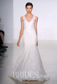 Brides.com: Our Favorite Lace Wedding Dresses from the Bridal Runways. Corded lace mermaid wedding dress with plunging v-neckline and low open back, Kenneth Pool  See more Kenneth Pool wedding dresses.