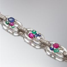 Like Tutti Frutti on ice, this unique Art Deco rock crystal, diamond and multi-gem Tutti Frutti bracelet, by Cartier, hits the auction block this Sunday at Leslie Hindman. See more highlights from the Chicago-based auction house's Important Jewelry sale on the blog! @lhauctioneers #tuttifrutti #cartier #rockcrystal #ruby #sapphire #emerald #diamond #importantjewelrysale #december6 #lesliehindman