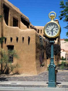 ^Santa Fe Street Clock^       Seen in the old Town of Santa Fe, the capital City of New Mexico.   Picture by  ~saxonfenken~ (Ken Hircock)  September 2 2010