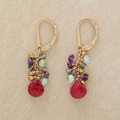 "EXUBERANCE EARRINGS -- A burst of glittering stones—peruvian opal, amethyst, brass, quartz—and 14kt gold filled beads gathers around the warm glow of a faceted ruby. 1-3/8""L."
