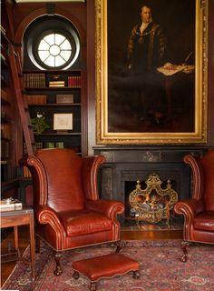 Leather armchair. , gentleman's club decor , open fireplace , dark wall colours visit www.windsorbrowne.co.uk
