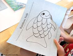 """This rainbow fish craft is the perfect companion to the beloved book """"The Rainbow Fish."""" It is so bright and colorful - kids love it! Rainbow Fish Bulletin Board, Fish Bulletin Boards, Rainbow Fish Crafts, Summer Lesson, Quiet Book Templates, Beloved Book, Work Activities, Preschool Themes, Sunday School Crafts"""
