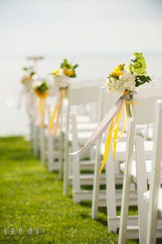 Flower decor with yellow, white, and grey ribbons for the ceremony aisle. Kent Island Maryland Chesapeake Bay Beach Club wedding photo, by wedding photographers of Leo Dj Photography. http://leodjphoto.com