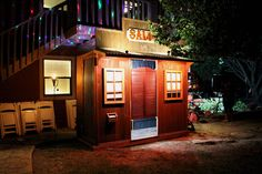 Our rustic western saloon photo booth all lit up at an outdoor wedding. http://thelookingglassphotobooths.com/