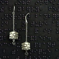 Braille Jewelry -Sterling Silver Braille Charm Earrings from Ohm Beads. The Braille charms are actually three pieces that turn freely to form any letter of the braille alphabet.