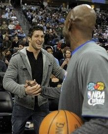 Tim Tebow and Los Angeles Clippers guard Chauncey Billups
