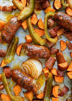 Sheet Pan Roasted Sausage with Sweet Potatoes and Peppers - get this easy dinner recipe at barefeetinthekitchen.com
