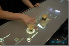Multi touch screen interactive coffee table designs to suit the modern needs of restaurants and cafes. Table Interactive, Interactive Touch Screen, Interactive Installation, Interactive Design, Multimedia, Digital Retail, Touch Screen Technology, Future Gadgets, 3d Video