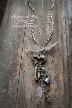 """The ideal necklace for vintage treasure hunters!! Antique key necklace embellished with rhinestones and an antique rhinestone flower. Chain drop with beads and """"LOVE"""" charm, curling wire wraps around, long 32"""" chain."""