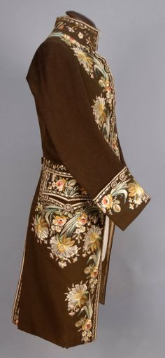 Coat, France, 1773-1794. Brown felted wool, decorated with polychrome silk floral, linen lining.