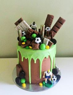 Layers by Grace: 3 layer chocolate cake with a vibrant green drip and soccer themed decorations. CONTACT ME THROUGH FACEBOOK FOR INQUIRIES