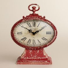 This would go perfect in my turquoise and red bedroom....One of my favorite discoveries at WorldMarket.com: Red Dory Clock
