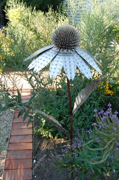 Purple coneflower metal sculpture by Kirk Yazel