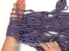 In this DROPS video we show you how to arm knit with a bulky yarn, in the end of this video we show how to arm knit a scarf/neckwarmer with three strands in DROPS Eskimo. Start with making a slipknot and slip it over your wrist. Hold the yarn in the other hand and start cast on. Cast on the number of stitches you wish. Adjust tension so loops are not too loose or tight. Knit to you have your desired length. Binding off with knit stitches, you knit the stitches and then keep passing the next…