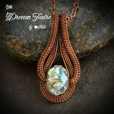 Swarovski Aurora Borealis Crystal and Copper Wire Pendant and Chain    A large, clear faceted Swarovski crystal bead is embraced by highly textured copper wire weave, and refracts light into all the colors of the rainbow.