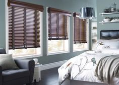 Coordinate existing bedroom decor with cloth tape wood blinds.