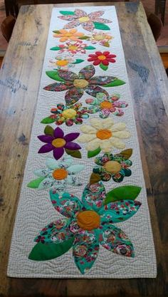 Blossoms Table Runner Paper Pattern – Free Bird Quilting Designs 2019 - - Wedding Decorations 2019 - World TrendsThe Blossoms table runner is an easy project perfect for a quick finish. The appliqué is made up of simple shapes and is laid onto the Mini Quilts, Small Quilts, Lap Quilts, Quilt Blocks, Patchwork Quilting, Applique Quilts, Longarm Quilting, Quilting Fabric, Hand Quilting