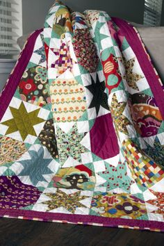 """""""Starstruck"""" quilt pattern by Vanessa Goertzen of Lella Boutique. Fabric is """"Avant-Garden"""" by Momo for Moda. A layer cake quilt."""