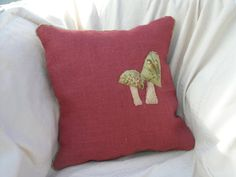 Original handmade red hessian cushion decorated with mushroom detail in raised embroidery/stumpwork. £39.00, via Etsy.