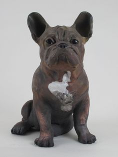 French Bull Dog by Ronnie Gould. French Bull dogs have huge personalities. This hand-built Frenchie is made from stoneware with applied porcelain slip and raku fired. Best to be enjoyed indoors and not left outside in freezing temperatures. $1,650