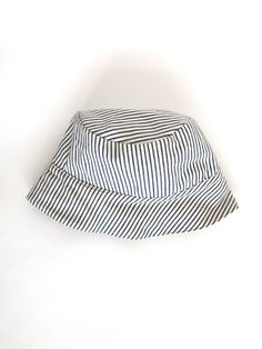 Love this pinstripe hat instead of the usual sports cap.