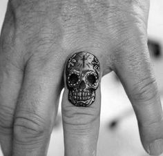 Tiny Small Day Of The Dead Finger Skull Tattoo For Guys