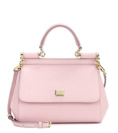 Dolce & Gabbana - Miss Sicily Small leather shoulder bag - Dolce & Gabbana's covetable Miss Sicily bag is ladylike in this coveted light pink hue. The classic smaller shape is finished with gold-tone accents for a timelessly glamorous look. For daytime, carry it next to pretty sun dresses or casual denim, swapping to a structured LBD come cocktail hour. seen @ www.mytheresa.com