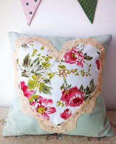 Sage green and pink floral cushion with vintage