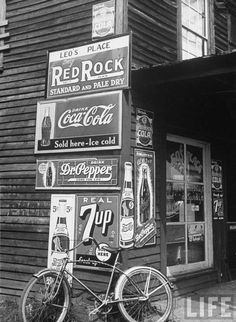 A food store called Leo's Place covered w. beverage ads incl. Coca-Cola, 7 UP, Dr. Pepper & Pepsi.  1938  Alfred Eisenstaedt
