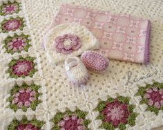 Beautiful.granny square baby blanket and matching hat and bootie set