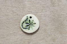 Ceramic pendant, glazed pendant, flower pendant, floral pendant, ceramic disc by BlackRabbitCeramics on Etsy Ceramic Pendant, Flower Pendant, Gemstone Rings, Pendants, Ceramics, Beads, Creative, Floral, Handmade