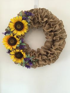A personal favorite from my Etsy shop https://www.etsy.com/listing/511788248/sunflower-wreath-burlap-wreath-sun