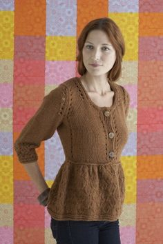 This peplum sweater cardigan will keep you cozy and snug.