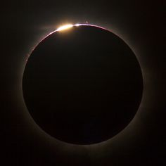 Total solar eclipse of November 13, 2012 from Queensland, Australia. Prominences are visible on the upper circumference.