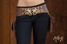 Two pocket belt with beautiful applique cut out designs in the sides and on the pockets. Speckled Brown with Tan Details, and Bronze and Brass