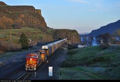 Catching the last two minutes of sun on this fine spring day, BNSF 8295 leads an auto train west at Lyle, Washington. Gotta love the silver and red at sunset.