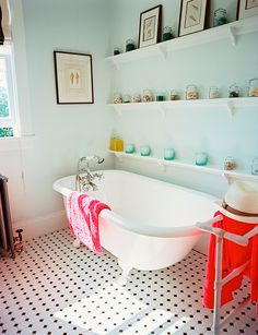 """Ditch your shower doors. If you've got one of those showers from the '60s with ugly sliding glass doors, you don't need a contractor to get rid of them, says Sarah Khandjian of SarahHearts.com. Use a razor blade to remove the caulking from the metal track. Next, unscrew the track. """"It should pop right off,"""" she says. Then fill in the screw holes in the tile with caulk—it comes in lots of colors. Put up a tension rod and hang a gorgeous curtain.  Change your showerhead, change your life…"""