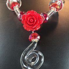 I'm blown glass red Lucite Rose Sterling findings#mostelfinejewelry #gratefulheart #whitespacecollection #wearableartjewelry #handblownglass #handblownglassjewelry http://ift.tt/1ODqPVb