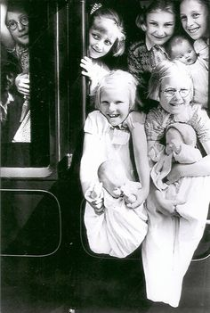 """""""This is my two older sisters being evacuated to Wales from Gillingham, Kent, England during World War II. They are the two in the front holding their dolls. I was too young to go with them.""""   --Florence Keels"""