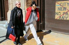 Street Style: New York Fashion Week Fall 2015 – Vogue Isabella Burley in a Louis Vuitton coat and Susie Lau in an Etre Cecile jumpsuit and jacket, and a Rodebjer coat