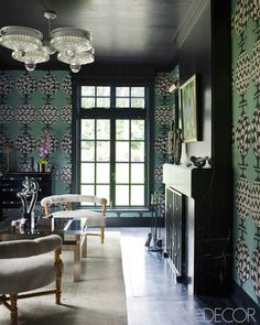 Kelly Wearstler via Elle Decor via Walls Surround You -- bold wall paper, dark ceiling and trim, fresh take on mantle, formal sitting area/lounge.