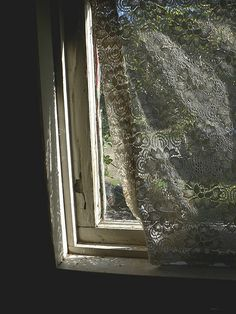old window with lace curtain
