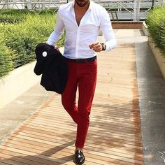 Shop this look on Lookastic: https://lookastic.com/men/looks/black-blazer-white-long-sleeve-shirt-red-chinos/20001   — White Long Sleeve Shirt  — Black Blazer  — Red Chinos  — Black Leather Loafers