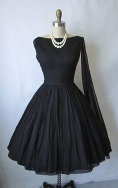 50's Dress...Cute silhouette to recreate for a wedding. Change the color & add embellishment that make you feel like a bride that stayed in her 'budget'. Work with your dressmaker to achieve this look.