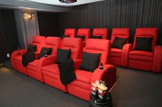 Loungers in this home theatre designed by CMID www.cmidesign.ca #CMID