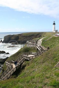Wooden stairs to beach misty day Yaquina Head Lighthouse Agate Beach Newport Oregon coast  Stock Photo