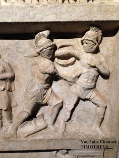"More on gladiators: https://www.youtube.com/watch?v=R3y2qEcG0k4&list=PLabDxfGj6LIcG80kg6yLHpm1xVcV_pSdQ&index=1 Hoplomachus (left) attacking a murmillo who has dropped his scutum. Note the horizontal centre grip. Pompeii, 20-50 CE. Gladiator exhibition (""Gladiatoren: Helden van het Colosseum""), Gallo-Romeins Museum, Tongeren (Belgium)."